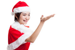 Asian Christmas Santa Claus girl  present space on her hand. Asian Christmas Santa Claus girl  present space on her hand  isolated on white background Royalty Free Stock Photography