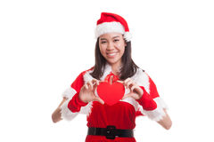 Asian Christmas Santa Claus girl with red heart. Asian Christmas Santa Claus girl with red heart  isolated on white background Royalty Free Stock Photography