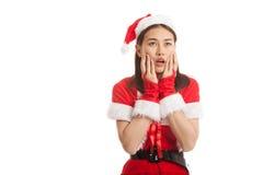 Asian Christmas Santa Claus girl  shock and look up. Royalty Free Stock Photo
