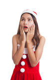 Asian Christmas Santa Claus girl  shock and look up. Royalty Free Stock Image