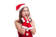 Asian Christmas Santa Claus girl  shock and look up. Royalty Free Stock Photography