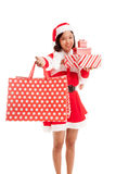 Asian Christmas Santa Claus girl with shopping bags and gift Stock Photography
