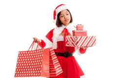 Asian Christmas Santa Claus girl with shopping bags and gift Royalty Free Stock Images