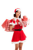 Asian Christmas Santa Claus girl with shopping bags and gift Royalty Free Stock Photography