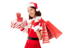 Asian Christmas Santa Claus girl with shopping bags and gift Stock Images