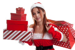 Asian Christmas Santa Claus girl with shopping bags and gift. Stock Photos