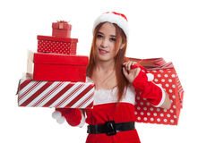 Asian Christmas Santa Claus girl with shopping bags and gift. Royalty Free Stock Images