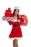 Asian Christmas Santa Claus girl with shopping bags and gift. Stock Images