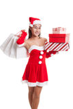 Asian Christmas Santa Claus girl with shopping bags and gift. Royalty Free Stock Photo
