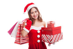 Asian Christmas Santa Claus girl with shopping bags and gift. Royalty Free Stock Photography