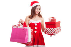 Asian Christmas Santa Claus girl with shopping bags and gift. Stock Photography