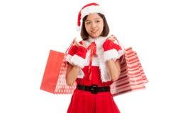 Asian Christmas Santa Claus girl with shopping bags Stock Photos