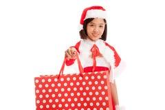 Asian Christmas Santa Claus girl with shopping bags Stock Photo