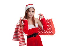 Asian Christmas Santa Claus girl with shopping bags. Stock Photography