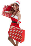 Asian Christmas Santa Claus girl with shopping bags. Stock Photo