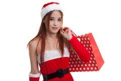 Asian Christmas Santa Claus girl with shopping bags. Stock Image