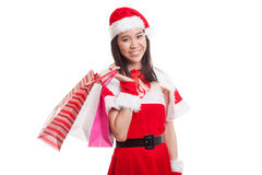 Asian Christmas Santa Claus girl with shopping bags. Stock Image
