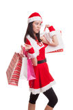 Asian Christmas Santa Claus girl with shopping bags. Royalty Free Stock Photography