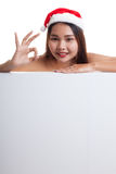 Asian Christmas Santa Claus girl show OK with blank sign. Stock Images