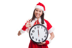 Asian Christmas Santa Claus girl show OK and clock at midnight. Asian Christmas Santa Claus girl show OK  and clock at midnight  isolated on white background Royalty Free Stock Photography