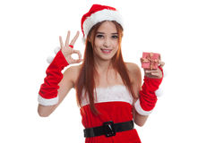 Asian Christmas Santa Claus girl show OK  and  gift box  isolate Royalty Free Stock Photography