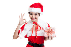 Asian Christmas Santa Claus girl show OK  and  gift box  isolate. D on white background Royalty Free Stock Images