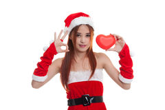 Asian Christmas Santa Claus girl  show OK with red heart. Asian Christmas Santa Claus girl  show OK  with red heart  isolated on white background Stock Photos