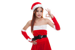Asian Christmas Santa Claus girl show Ok sign. Royalty Free Stock Photos