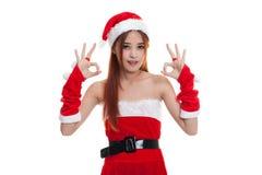Asian Christmas Santa Claus girl show OK sign. Stock Photography