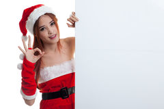 Asian Christmas Santa Claus Girl Show OK With Blank Sign. Royalty Free Stock Images