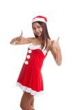Asian Christmas Santa Claus girl show 2 thumbs up. Stock Photos