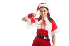 Asian Christmas Santa Claus girl  thumbs down. Stock Photography
