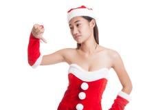 Asian Christmas Santa Claus girl  thumbs down. Stock Photos
