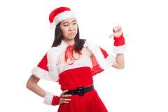 Asian Christmas Santa Claus girl  thumbs down. Royalty Free Stock Images