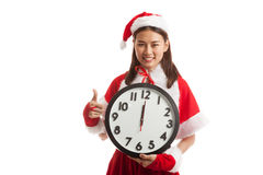 Asian Christmas Santa Claus girl  thumbs up and clock at midnigh. T  isolated on white background Stock Image
