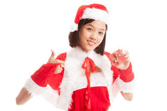 Asian Christmas Santa Claus girl  thumbs up with  gift box. Isolated on white background Stock Image