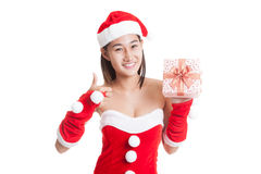 Asian Christmas Santa Claus girl  thumbs up with  gift box. Asian Christmas Santa Claus girl  thumbs up with  gift box  isolated on white background Royalty Free Stock Photo