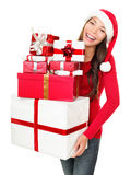 Asian christmas santa woman shopping gifts. Asian christmas santa woman shopping holding many gifts wearing santa hat smiling happy. Beautiful female model Stock Image