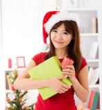 Asian Christmas woman with gift Stock Photo