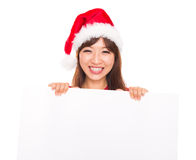 Asian Christmas woman over billboard sign. Asian Christmas woman wearing Santa hat over billboard sign, isolated on white background Stock Photography