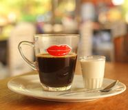 Asian cofe with milk served on table. Close up photo Stock Images