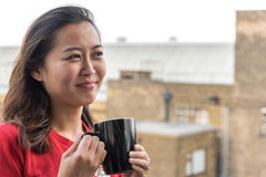 asian coffee drinking girl Στοκ Εικόνες