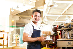 Asian Coffeeshop - barista presents coffee Stock Image