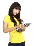Asian college girl reading a book Royalty Free Stock Photography