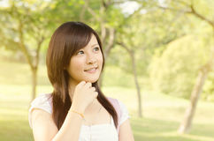 Asian college girl student thinking Royalty Free Stock Photos