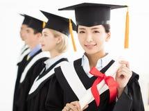 College graduate at graduation with classmates Stock Photos