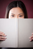 Asian college student. A shot of a beautiful asian college student reading stock image
