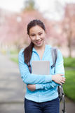 Asian college student. A shot of an Asian college student on campus royalty free stock photo