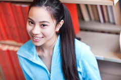 Asian college student. A portrait of an Asian college student studying in the library royalty free stock image