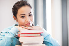 Asian college student. A portrait of an Asian college student studying in the library royalty free stock images